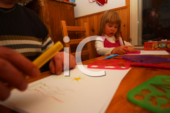 Royalty Free Photo of a Little Girl Doing Crafts