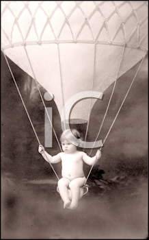 Royalty Free Photo of a Child Sitting in a Hot Air Balloon