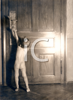Royalty Free Photo of a Naked Child Reaching for a Door Child