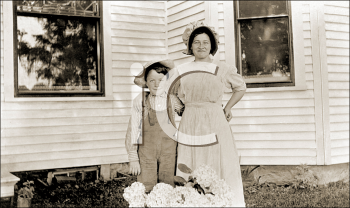 Royalty Free Photo of a Mother and Son Standing Outside of a House