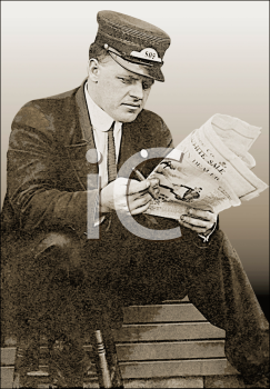 Royalty Free Photo of a Railroad Conductor Reading a Newspaper