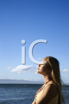 Royalty Free Photo of Young Woman Standing on a Beach in Maui Hawaii