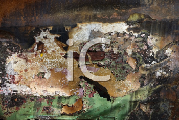 Close-up detail of old abandoned and rusted car.