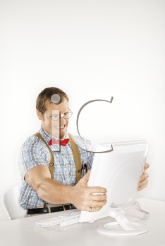Royalty Free Photo of a Man Dressed Like a Nerd Holding a Computer Monitor in Frustration