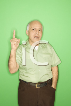 Royalty Free Photo of an Older Man Holding His Finger Up