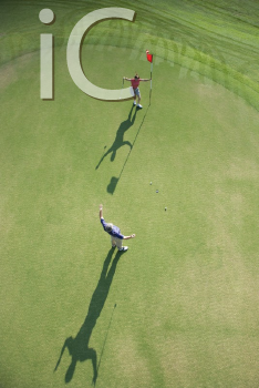 Royalty Free Photo of an Aerial View of an Excited Man and Woman on a Golf Course at Bald Head Island, North Carolina