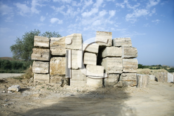 Royalty Free Photo of a Travertine Stone Excavated From an Open Mine Quarry