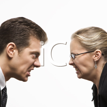Royalty Free Photo of a Businessman and Businesswoman Staring at Each Other With Hostile Expressions