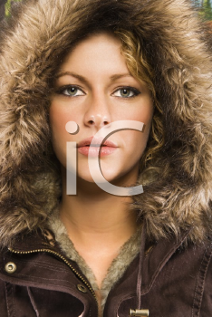 Royalty Free Photo of a Woman Wearing a Fur Hood