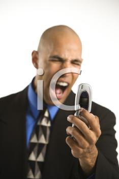Royalty Free Photo of a Man Yelling at a Cellphone