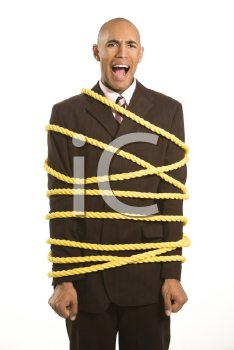 Royalty Free Photo of a Businessman Wrapped in Yellow Rope Screaming
