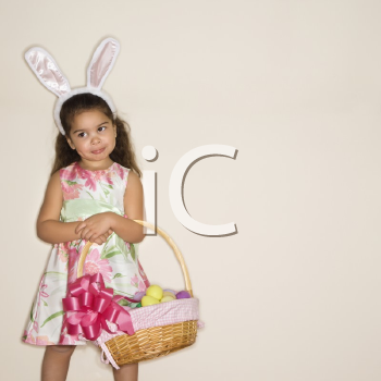 Royalty Free Photo of a Girl Holding an Easter Basket Smiling