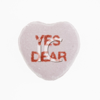 Purple candy heart that reads yes dear against white background.