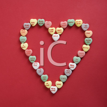 Royalty Free Photo of Candy Hearts With Sayings on Them Arranged in the Shape of a Heart