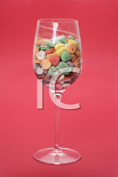 Royalty Free Photo of a Wine Glass Full of Candy Hearts