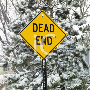 Royalty Free Photo of a Snowy Scene in a Suburb With Evergreen Trees and a Dead End Road Sign