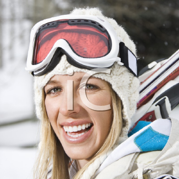 Royalty Free Photo of a Blond Woman in Winter Ski Gear Smiling