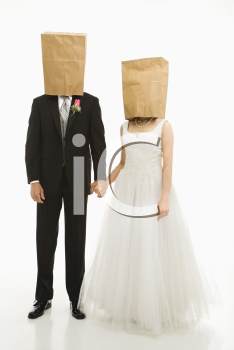 Royalty Free Photo of a Bride and Groom With Paper Bags Over Their Heads