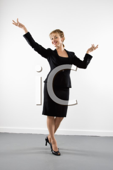 Royalty Free Photo of a Businesswoman Standing With Arms Outstretched and Smiling