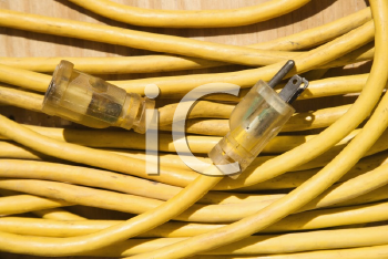 Royalty Free Photo of a Yellow Electric Extension Cord