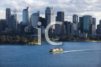 Royalty Free Photo of an Aerial View Ferryboat Crossing a Harbour With Skyline of  Sydney, Australia