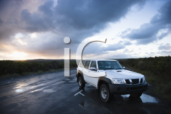 Royalty Free Photo of a Sport Utility Vehicle Parked on Great Ocean Road in Australia