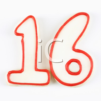 Royalty Free Photo of a Sugar Cookie in the Shape of a Number Sixteen Outlined in Red Icing