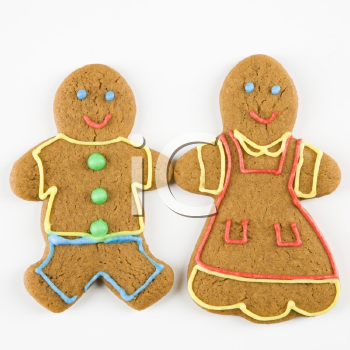 Male and female gingerbread  cookies holding hands.