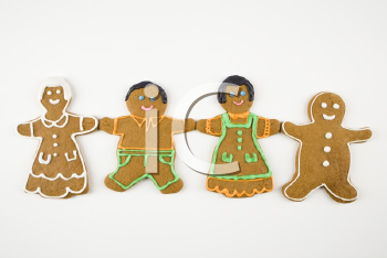 Royalty Free Photo of Four Gingerbread Cookies Holding Hands