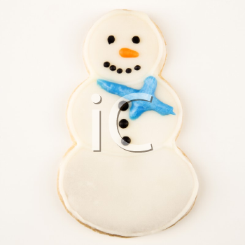 Snowman sugar cookie with decorative icing.