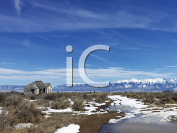Royalty Free Photo of a Scenic Landscape in Rural Snowy Colorado of an Abandoned House