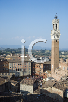 High angle view of Piazza del Campo and surrounding buildings in Siena, Italy. Vertical shot.