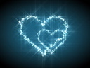 Royalty Free Video of Glowing Blue Hearts