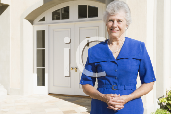 Royalty Free Photo of a Senior Woman Outside Her Home