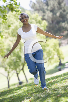 Royalty Free Photo of a Woman Walking in a Park