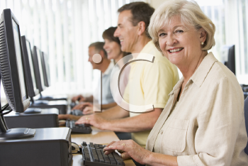 Royalty Free Photo of Four People Sitting at Computer Terminals