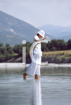 Royalty Free Photo of a Woman Walking in Shallow Water