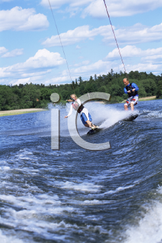 Royalty Free Photo of Two People Water Skiing