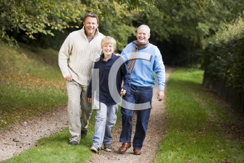 Royalty Free Photo of a Grandfather, Father and Son Walking on a Trail