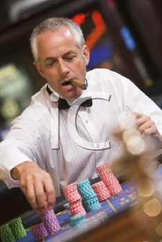 Royalty Free Photo of a Man With a Cigar at a Roulette Table