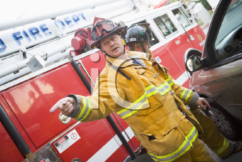 Royalty Free Photo of Firefighters With the Jaws of Life at a Car Crash