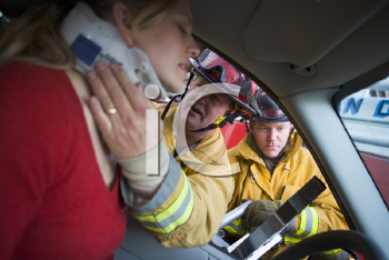 Royalty Free Photo of Firefighters Helping a Driver
