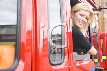 Royalty Free Photo of a Woman Sitting in the Firetruck