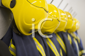 Royalty Free Photo of Firefighting Suits Hanging in a Row