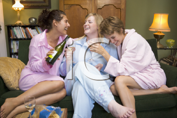 Royalty Free Photo of Three Women at Home Drinking Wine