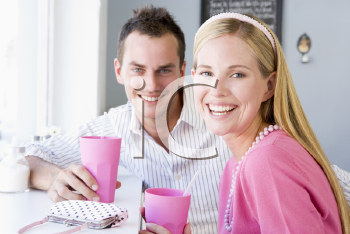 Royalty Free Photo of a Couple Having a Cold Drink