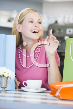 Royalty Free Photo of a Woman Taking a Break From Shopping