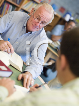 Royalty Free Photo of Two Men Working Together in a Library