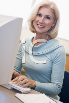 Royalty Free Photo of a Woman Sitting at a Computer