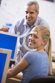 Royalty Free Photo of a Teacher With a Female Student in Computer Class